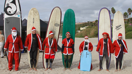 Surfers Dress Like Santa to Raise Money for Children with Autism