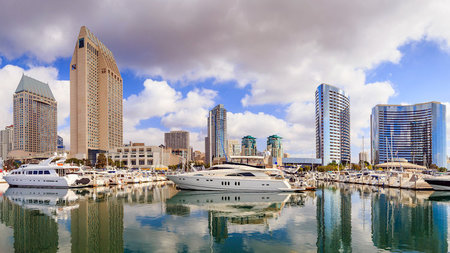 How does chartering a private yacht compare with vacationing at a luxury hotel?