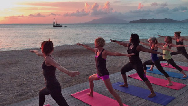 Yoga at Paradise Beach Nevis with St. Kitts view
