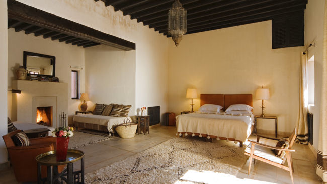 Kasbah Bab Ourika bedroom with fireplace